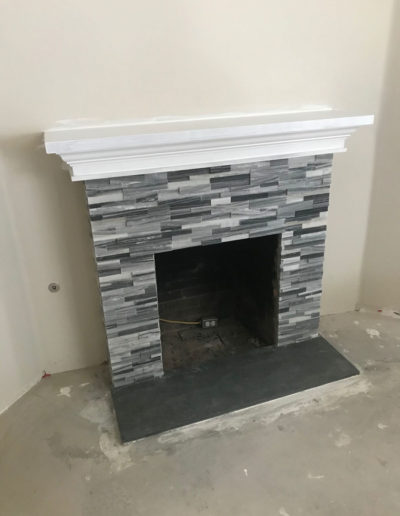 stacked stone fireplace, grey, black, and white