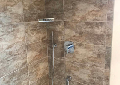 Colorful Tile & Stone Shower