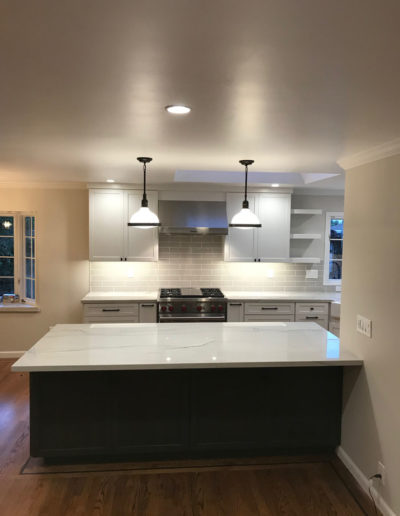 white kitchen remodel with pendant lighting