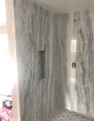 grey shower with insets