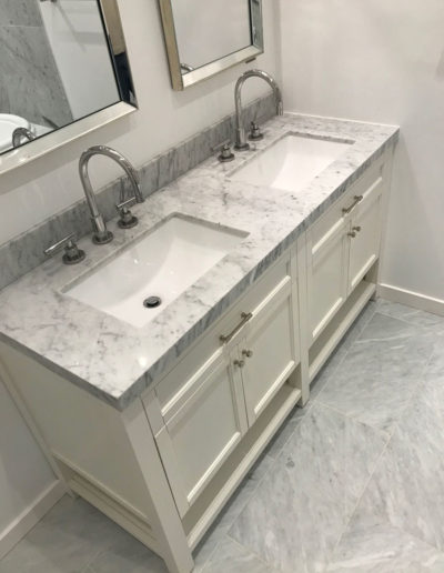 dual sink grey and white, cream cabinets
