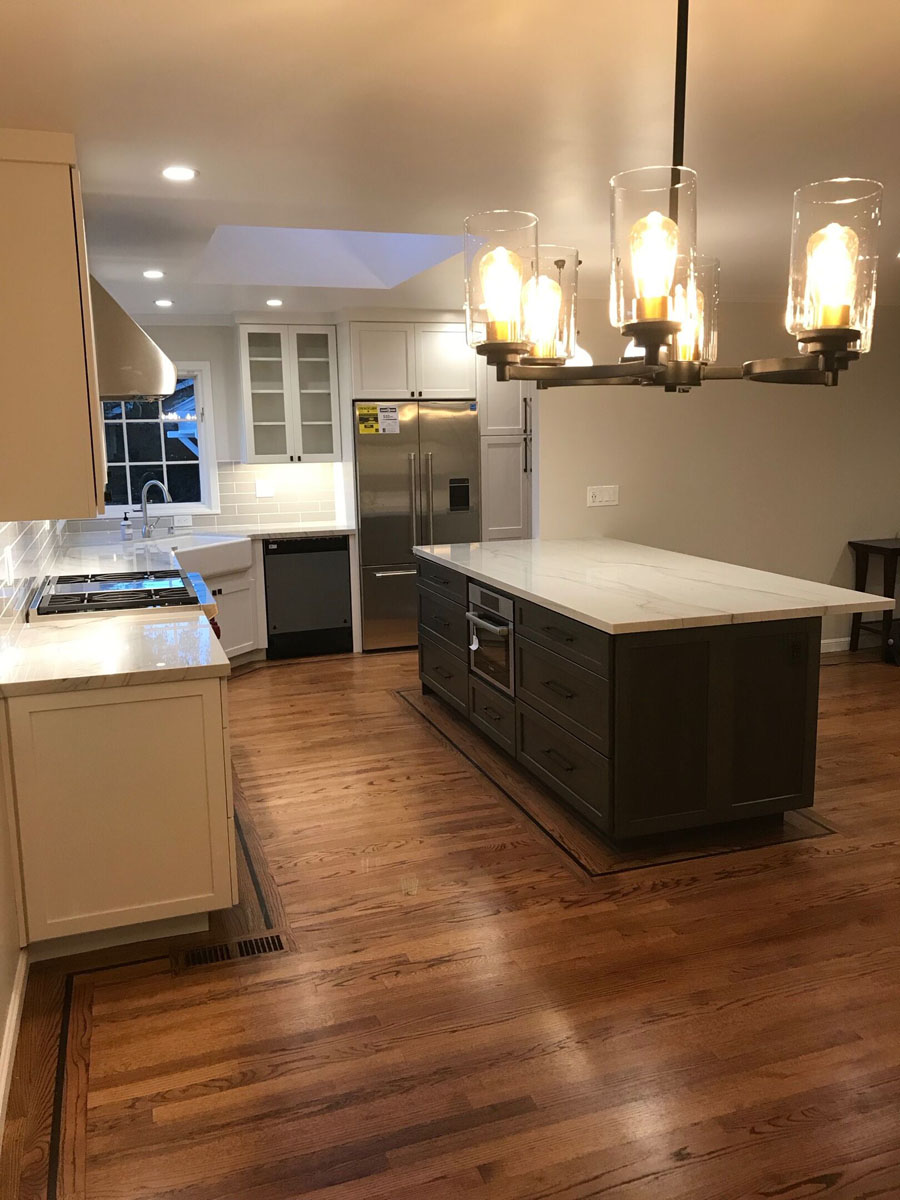 dark island, white cabinets, built-in microwave - kitchen remodel in Bay Area