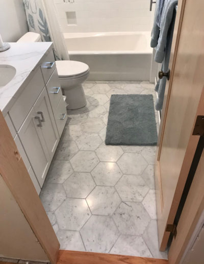 honeycomb hexagon tile in grey and white bathroom