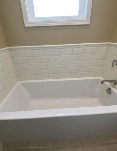 bathtub with white tile