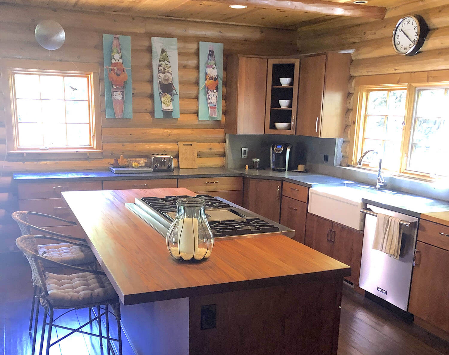 Rustic country log cabin kitchen with wood island